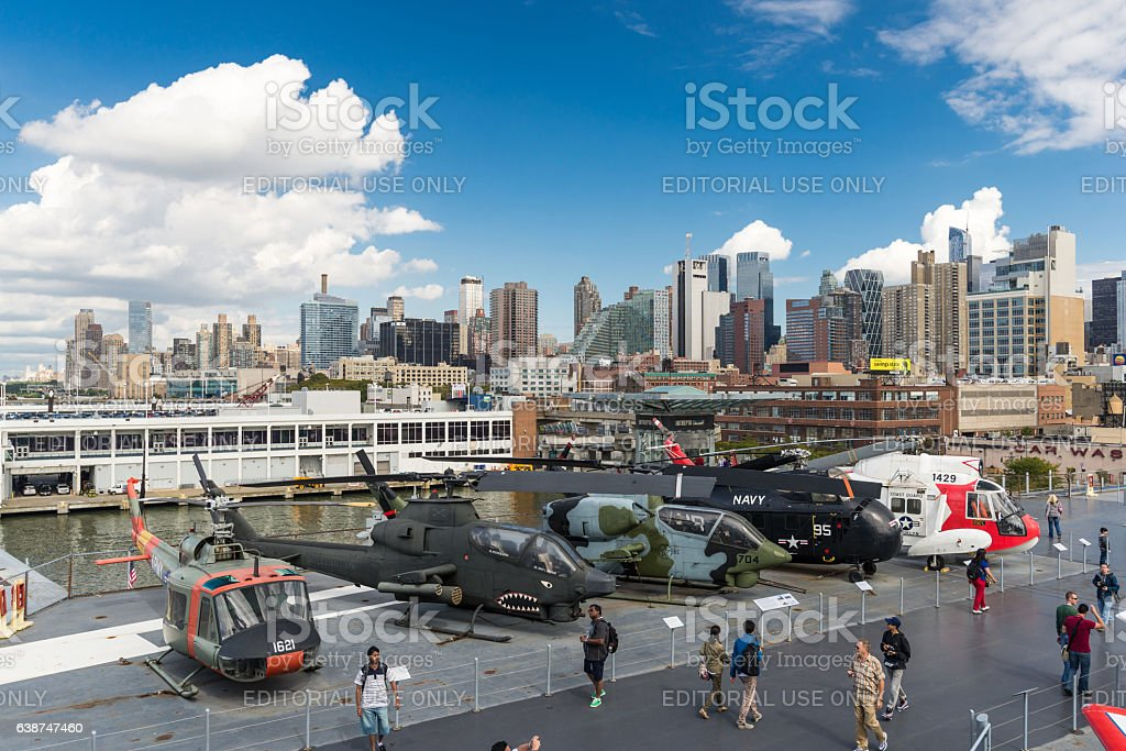 people at Intrepid museum on the background of Manhattan stock photo