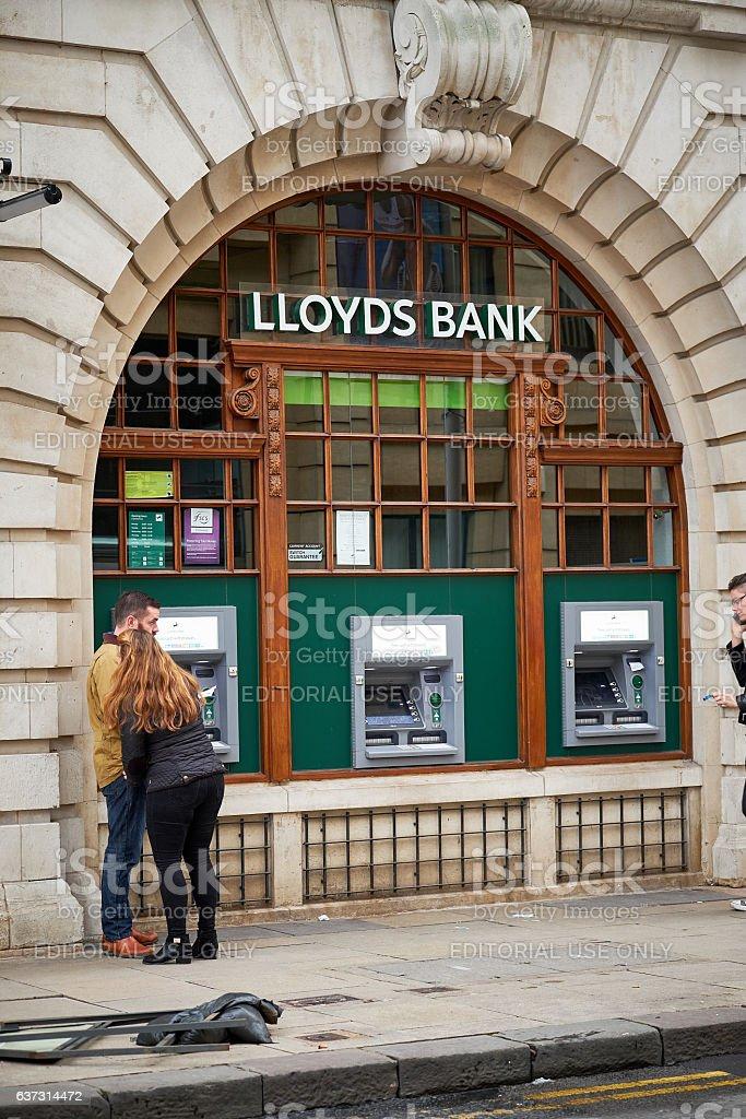 People at Lloyds bank atm, cash dispenser stock photo