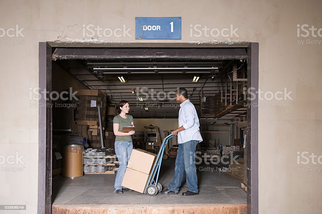 People at loading bay stock photo