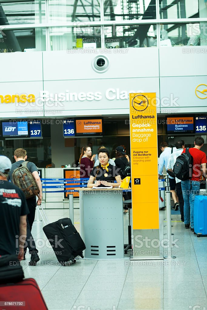 People at Lufthansa Business Class check-in stock photo
