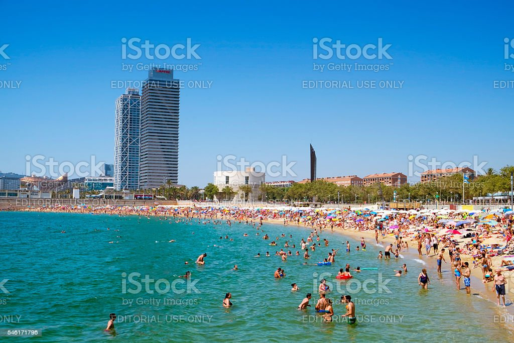 people at Nova Icaria Beach, in Barcelona, Spain stock photo