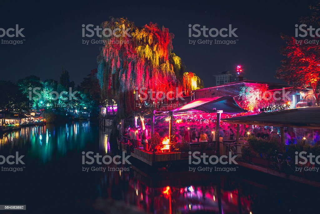 people at outdoor club in berlin at night stock photo