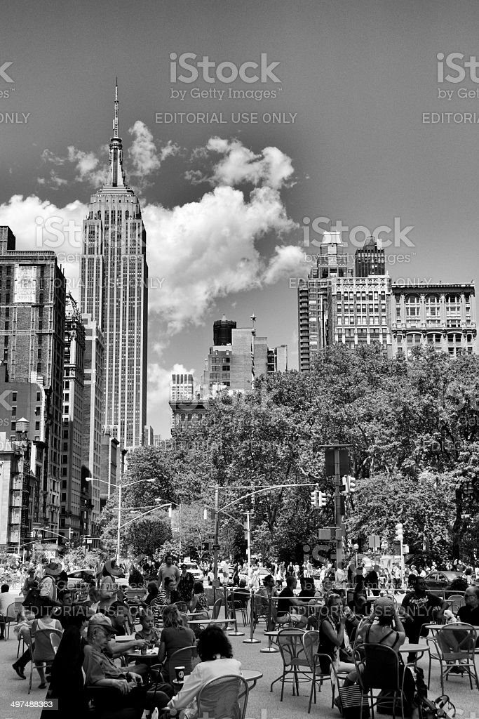 People at Outdoor Seating, Empire State Building Cityscape, Manhattan, NYC royalty-free stock photo