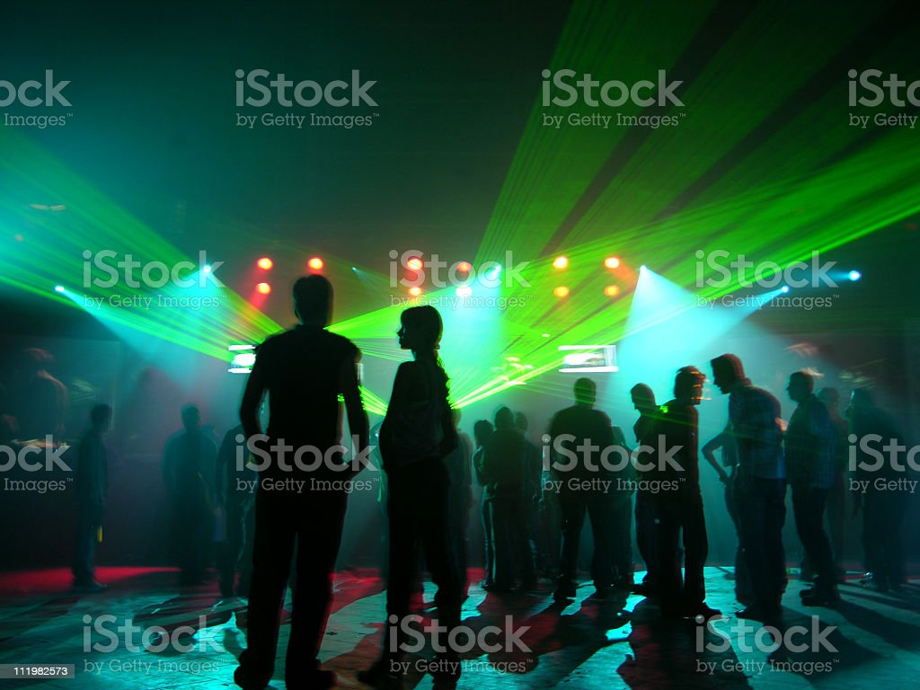 People at party with bright lights stock photo