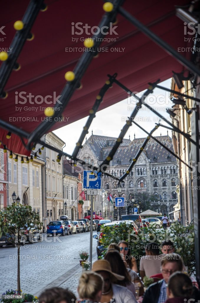 People at patio of Pest Buda Bistro with Hungarian National Archive stock photo
