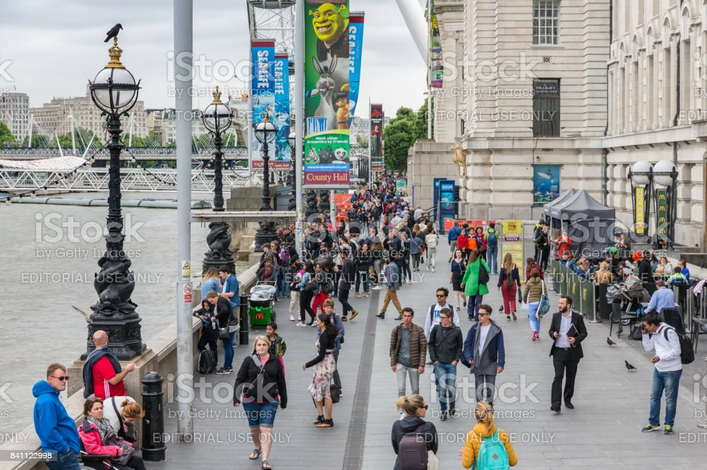 People at promenade between London Eye and Westminster Bridge, London stock photo