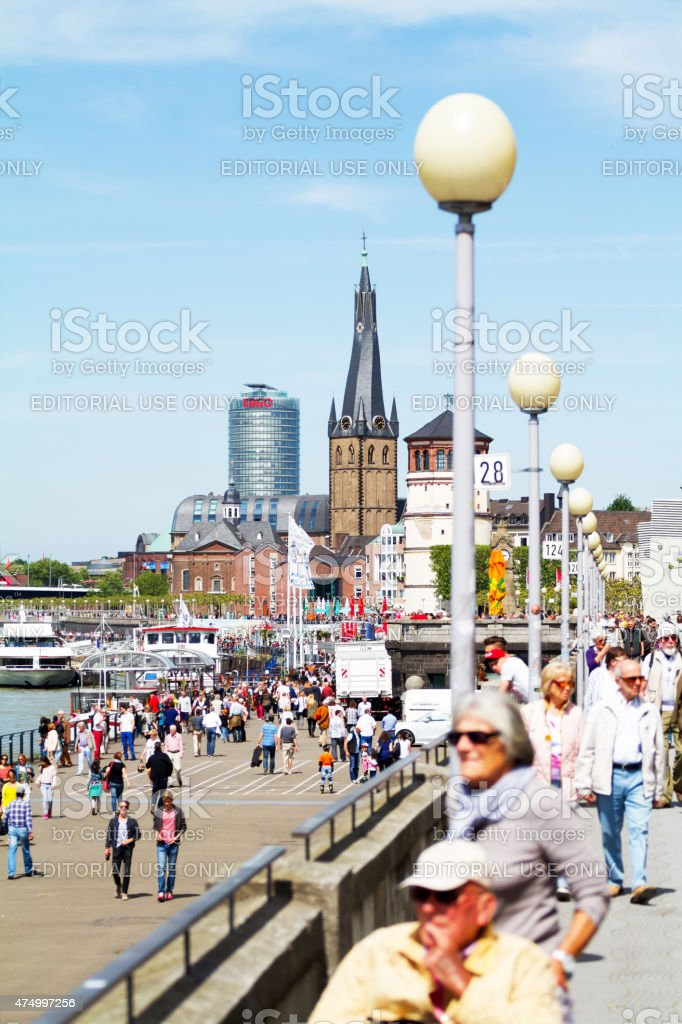 People at Rhine in sunny spring day stock photo