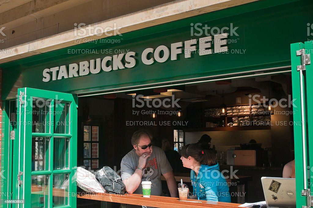 People at Starbucks Coffee House, London, UK stock photo