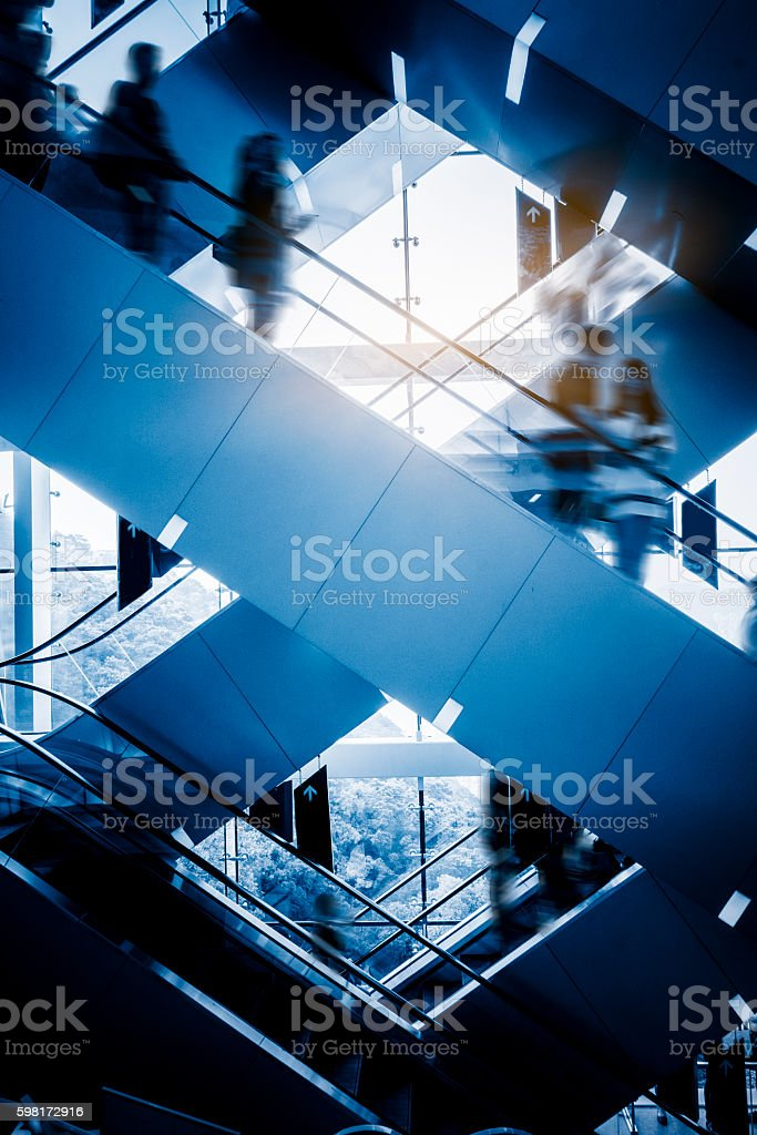 People at the airport escalator.Motion blur stock photo