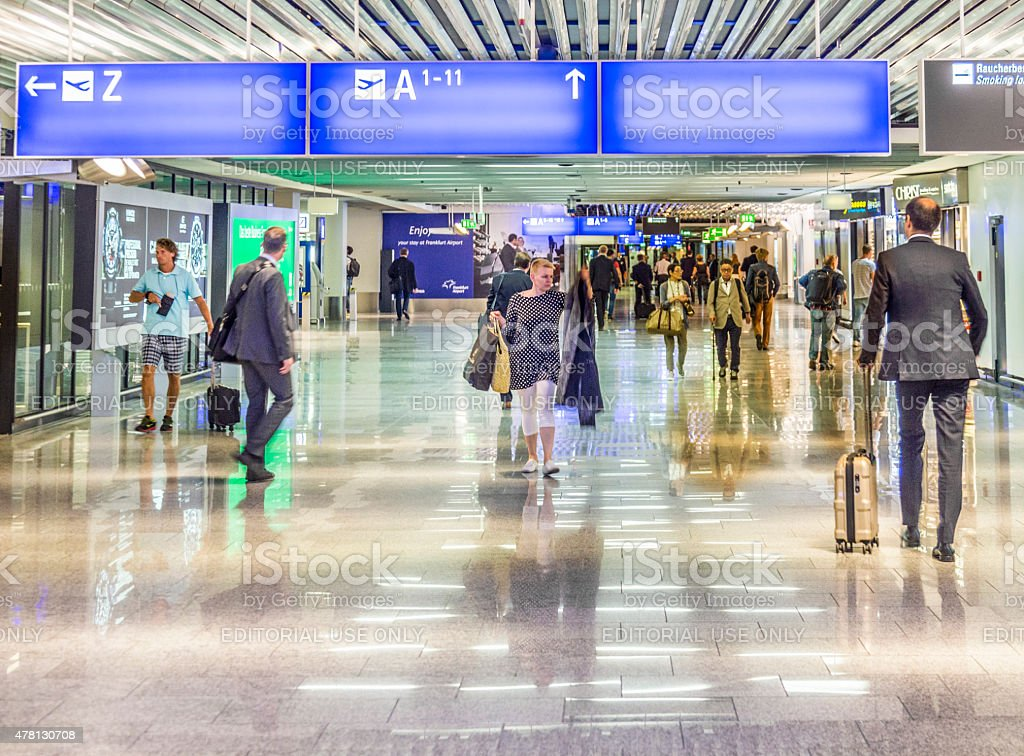people at the Airport in the evening in Frankfurt stock photo