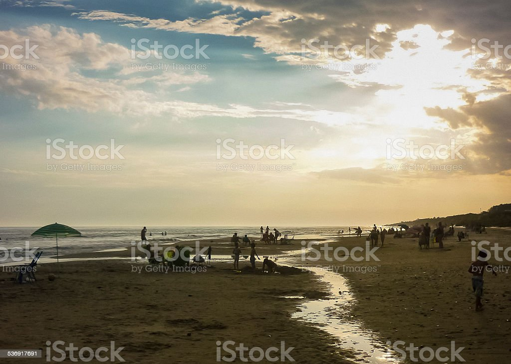 People at the Beach at Sunset stock photo