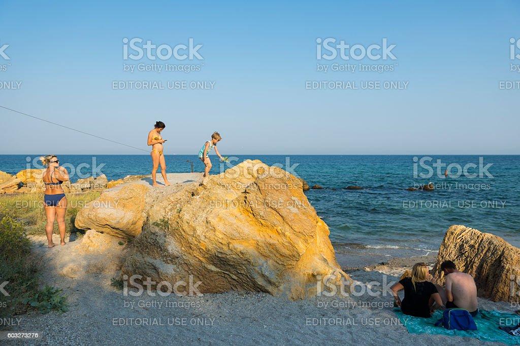 People at the Black Sea in Odessa, Ukraine stock photo