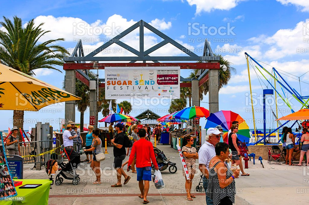 People at the entrance to the Clearwater beach pier, Florida stock photo