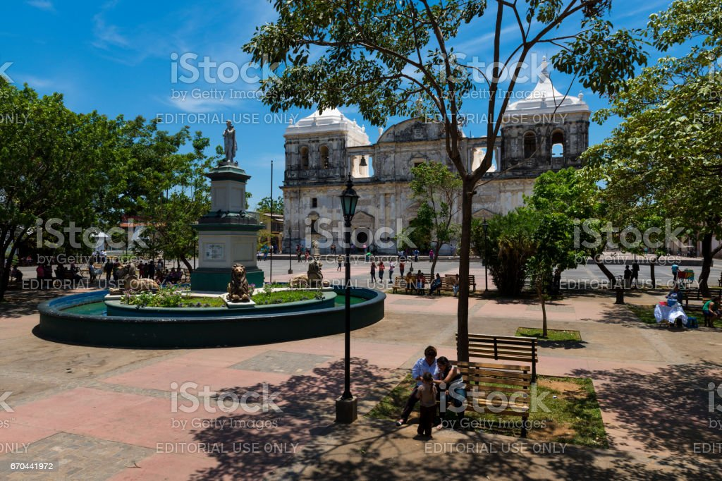 People at the Parque Central with the Cathedral of Leon (Our Lady of Grace Cathedral) on the background in Nicaragua, Central America stock photo