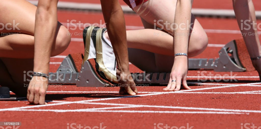 People at the starting line on a race track royalty-free stock photo