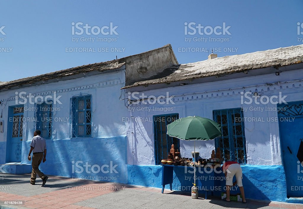 People at the street of Chefchaouen in northern Morocco. stock photo