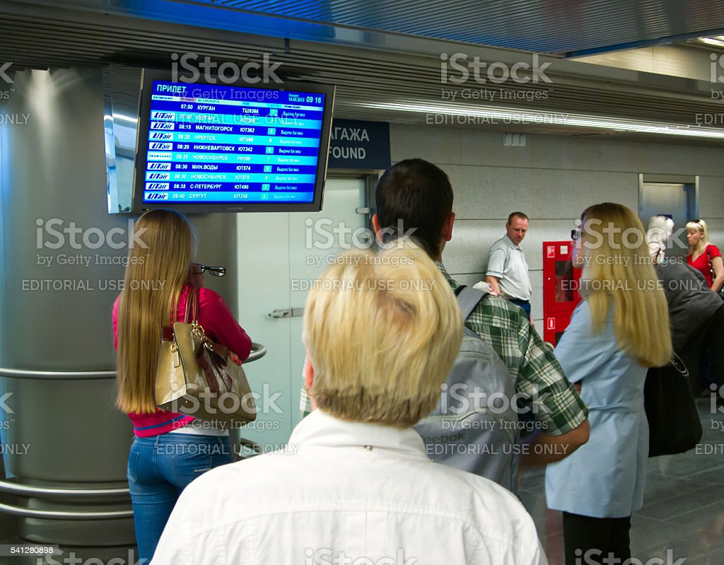 People at the Vnukovo airport arrivals flights stock photo