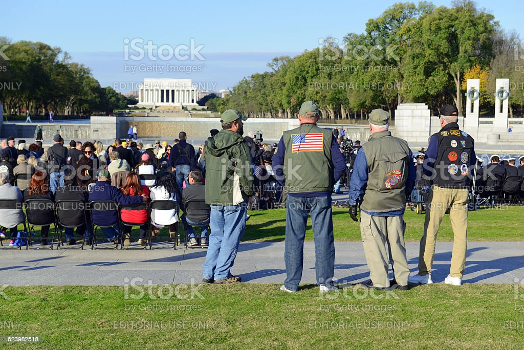 People at the World War II Memorial on Veterans' Day stock photo