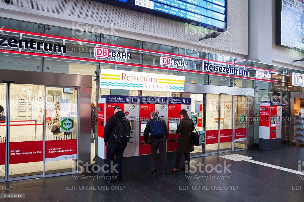 People at ticket machines stock photo