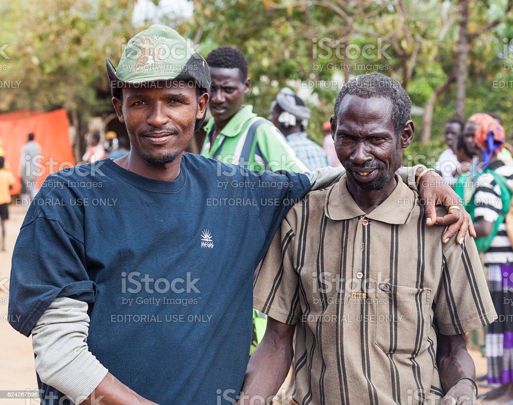 People at village market. Bonata. Omo Valley. Ethiopia. stock photo