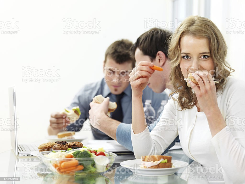 People at work having lunch royalty-free stock photo