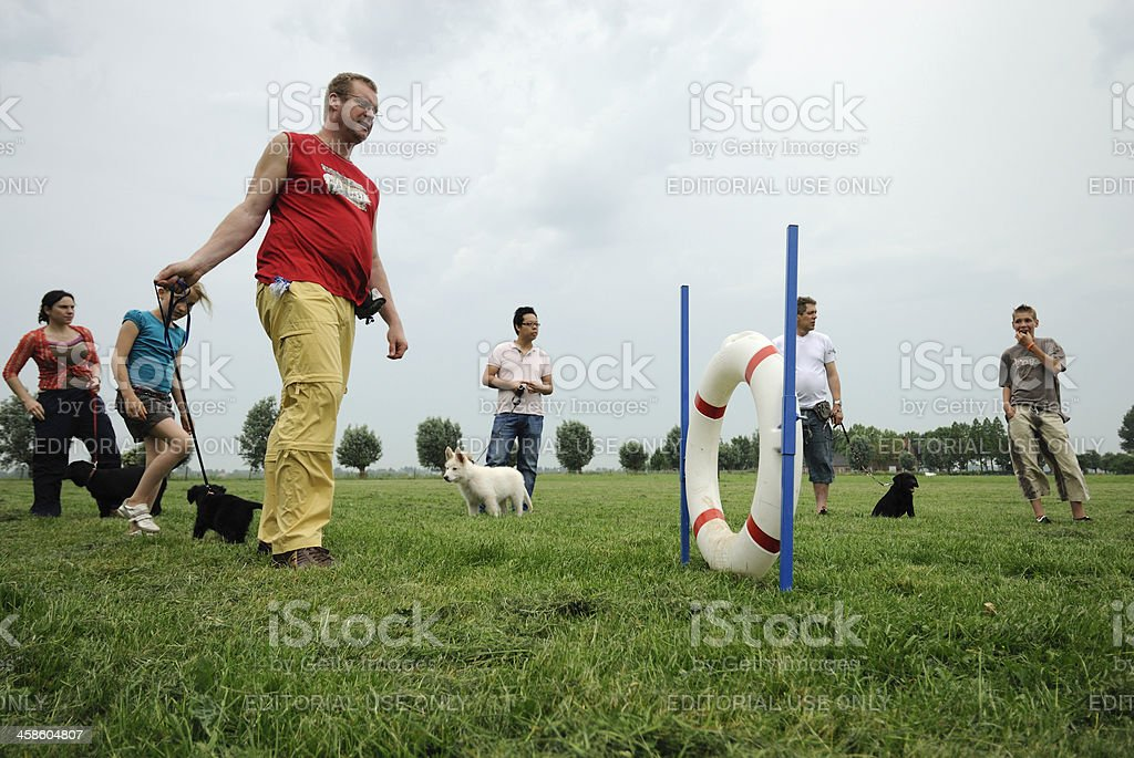 People attending a basic obedience training for puppy dogs royalty-free stock photo