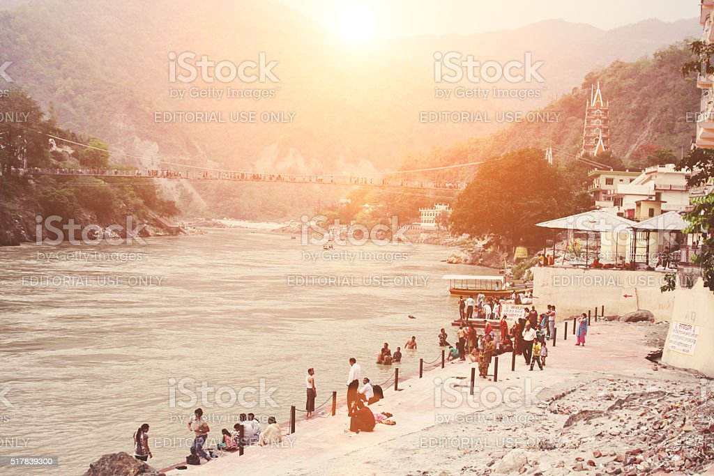 People bathe in the Ganges river in Rishikesh city center stock photo