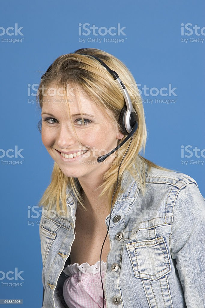 People - Beautiful blonde woman with a headset on royalty-free stock photo