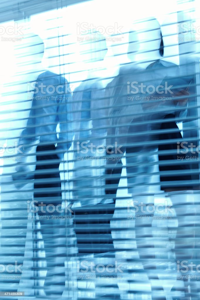 People behind the blinds royalty-free stock photo