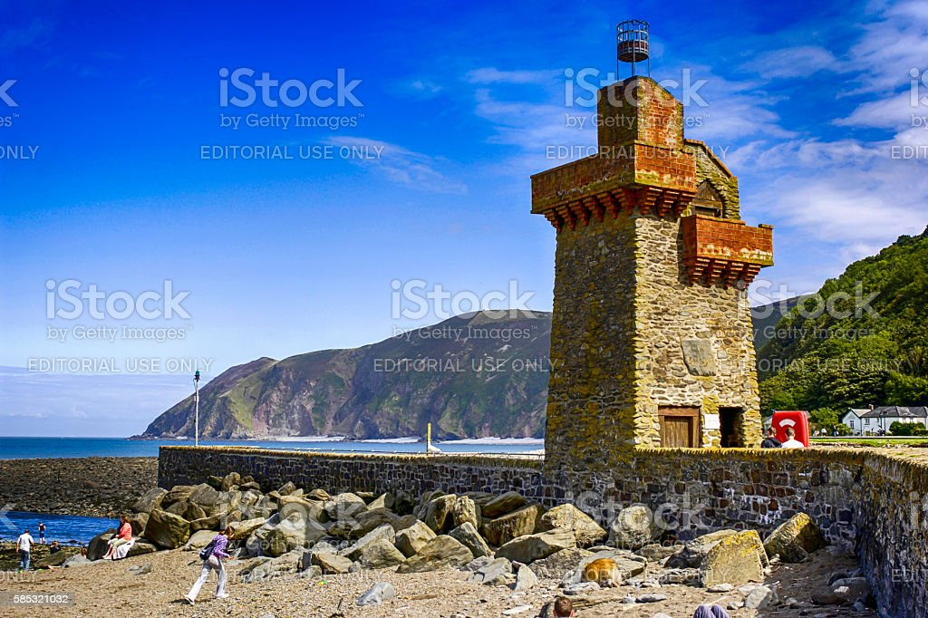 People below the harbour entrance beacon at Lynmouth, UK stock photo