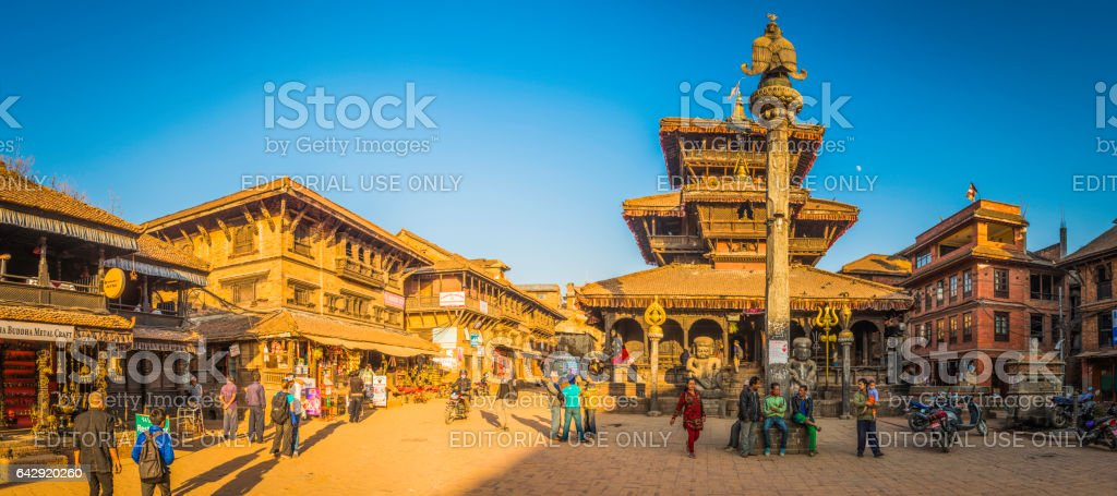 People beside ancient temples Bhaktapur Duttatraya Square panorama Kathmandu Nepal stock photo