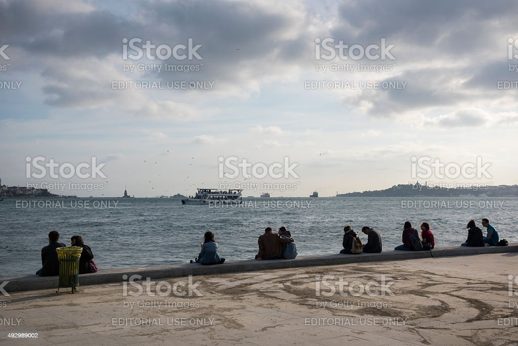 People beside the Bosphorus in Istanbul, Turkey stock photo