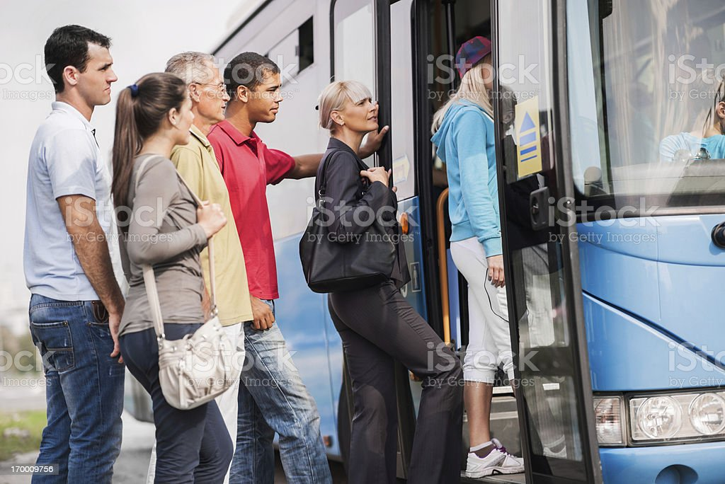 People boarding a bus. stock photo