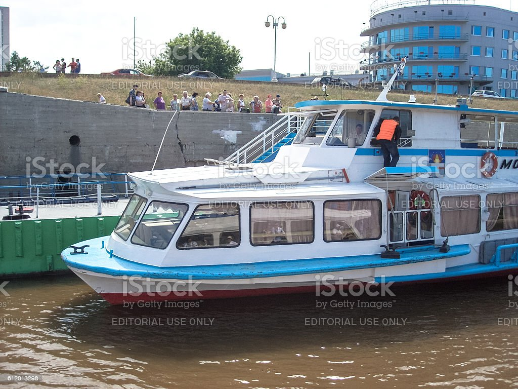 People boarding a ferryboat in Omsk town stock photo