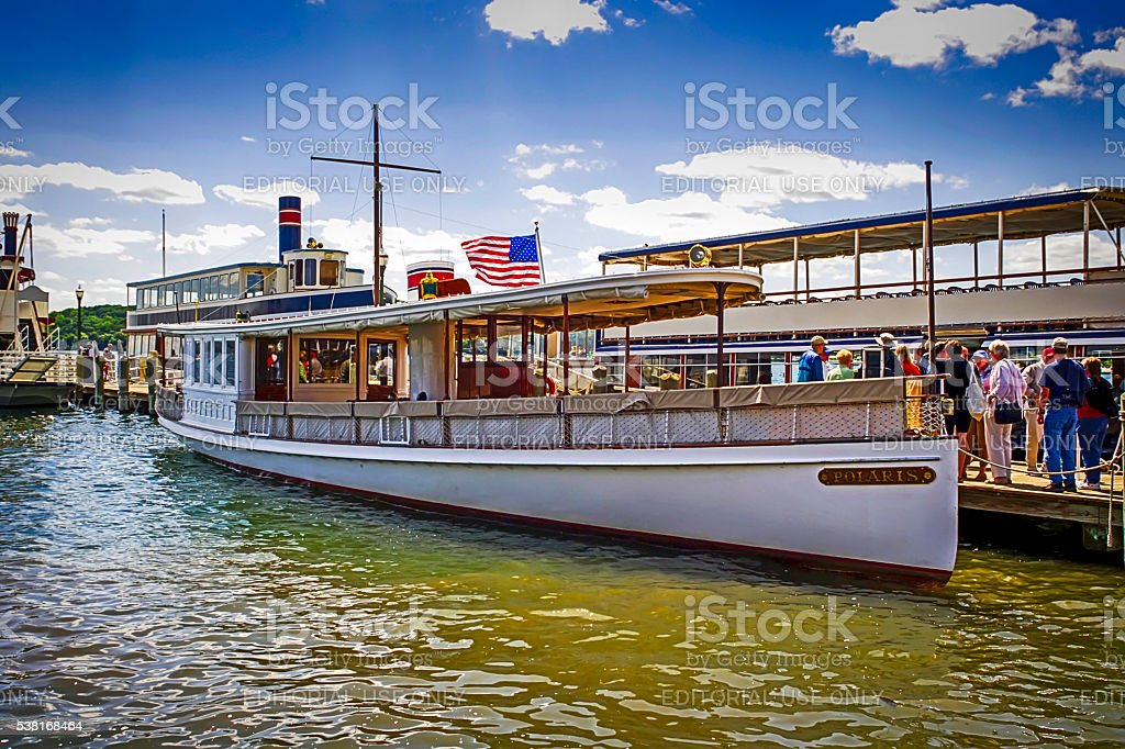 People boarding a tourist steamboat on Lake Geneva in Wisconsin stock photo