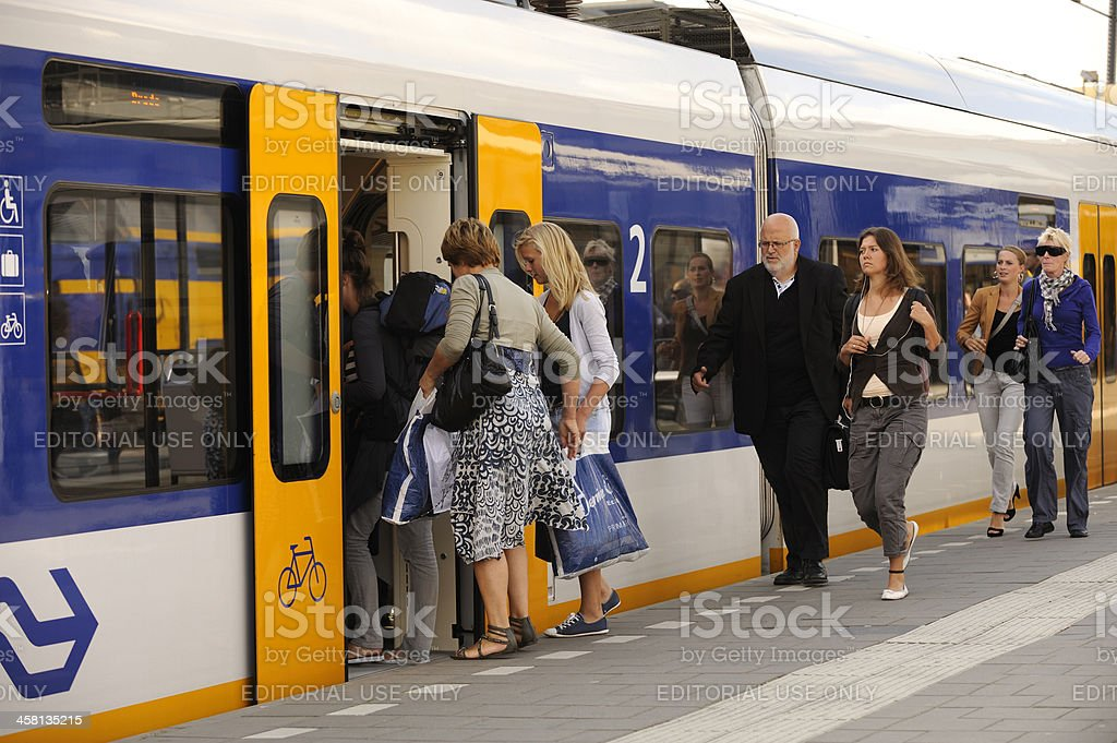 People boarding a train at Utrecht Centraal railway station royalty-free stock photo