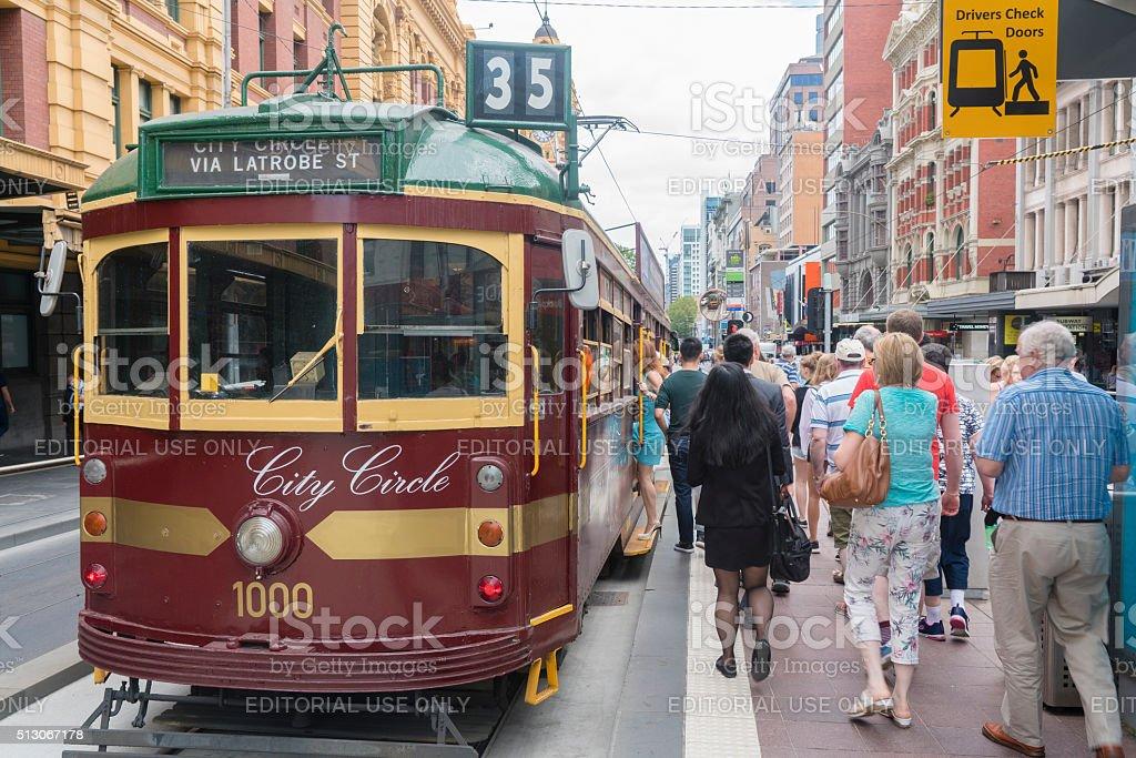 People boarding a tram in Melbourne stock photo