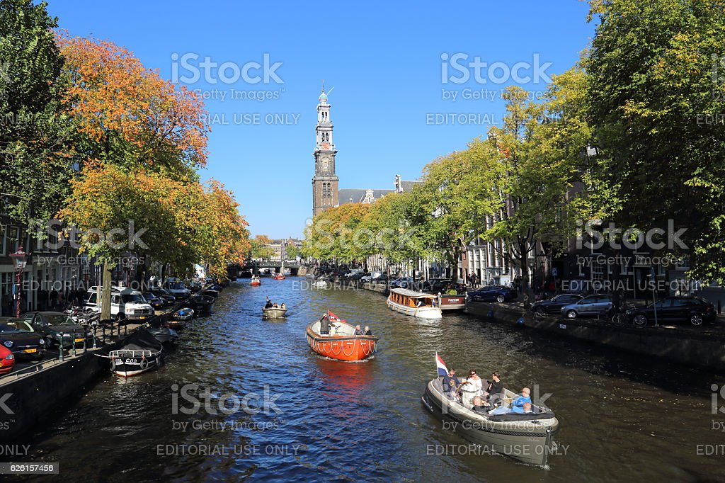 People boating in Amsterdam, Holland stock photo