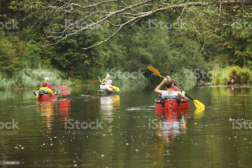 People boating on river stock photo