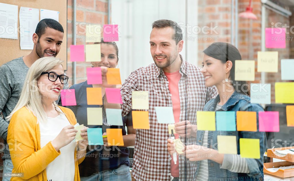 People brainstorming at a creative office stock photo