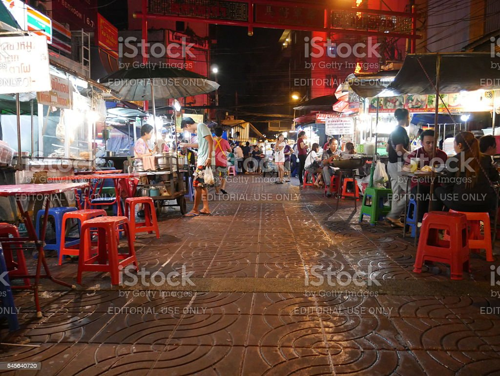 People bustling and traffic in China Town of Bangkok stock photo