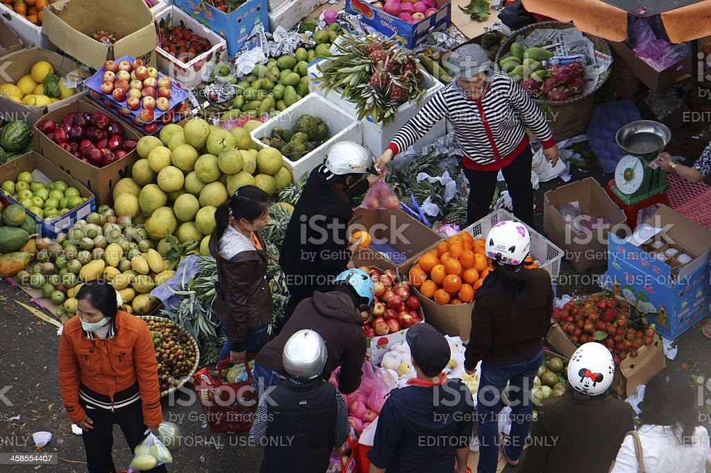 People buy and sell fruit at market stock photo