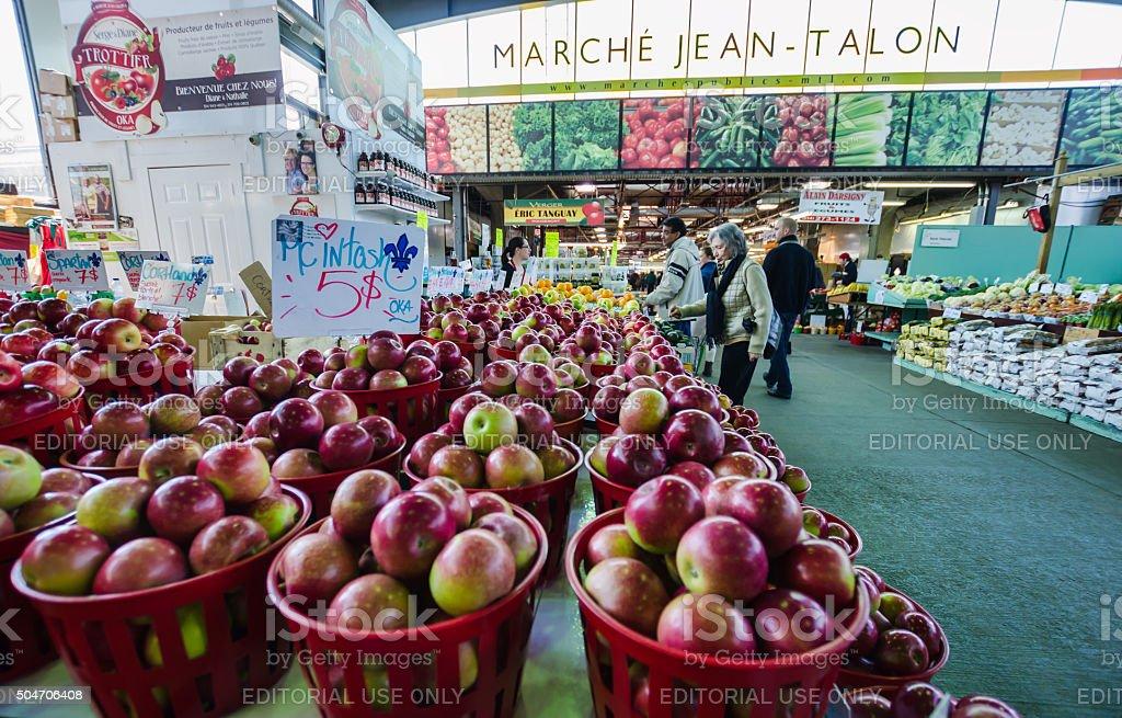 People buy groceries at Jean-Talon Market stock photo