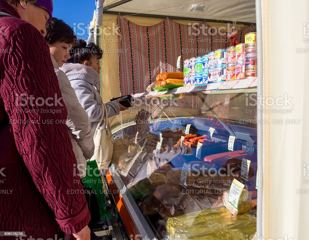 People buy products on the street the point of sale stock photo