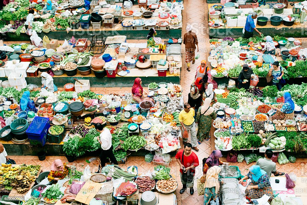 People buying and selling in a vegetable garden. stock photo