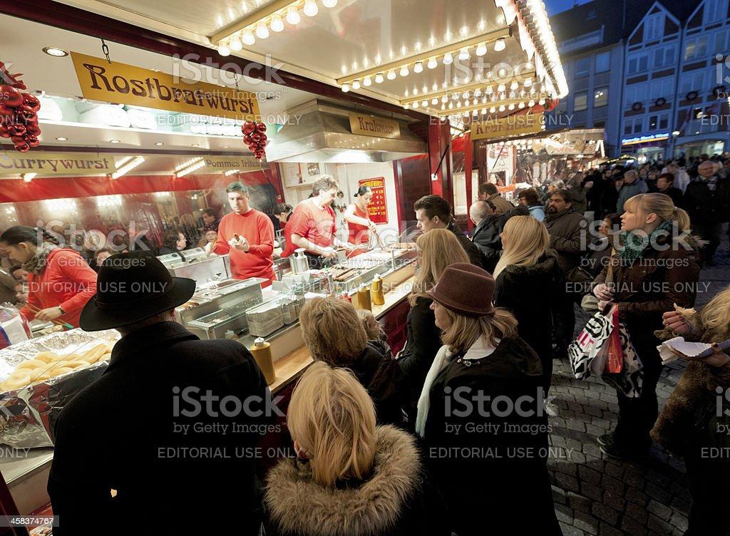 people buying bratwurst at Christmas Market in Dusseldorf Germany stock photo