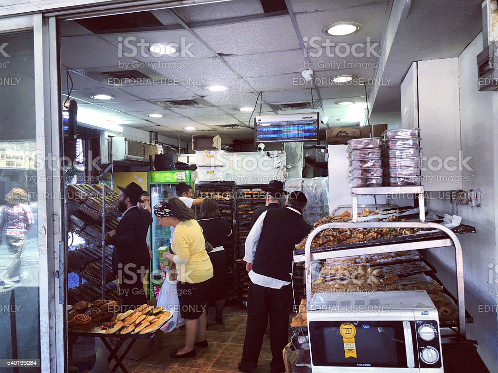 People buying bread in Bnei Brak, Israel stock photo
