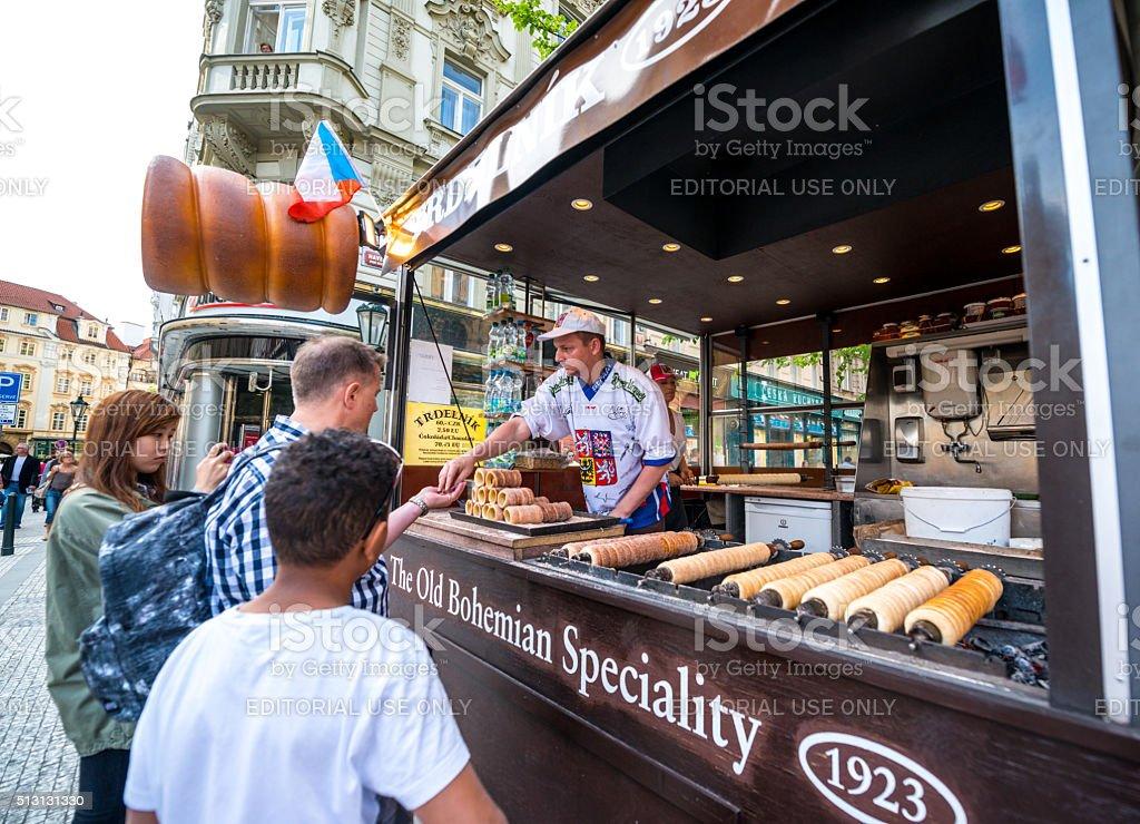 People buying famous Trdelnik in Prague stock photo