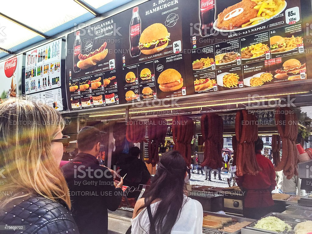 People buying fast food in a street kiosk, Prague stock photo