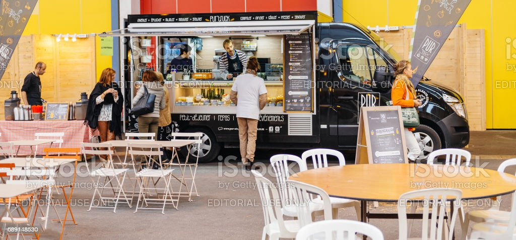 People buying food at Food truck on the street stock photo